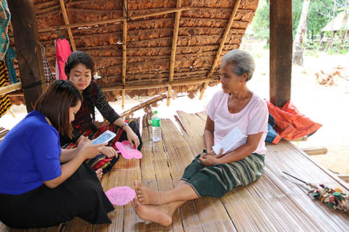 Daw Ma Shar, pictured to the right, is a widow and is one of the beneficiaries of the livelihood support programme.  Her husband passed away by thundering. The interviewers are Nan Shwe Hla Kyi, Field Supervisor of Hpa-an Villages and Naw Pankalyar Moe Thuzar, Field Staff of Thandaunggyi Villages.