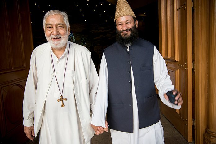 Interfaith dialogue in Pakistan.Bishop of the Central Cathedral of praying hands, Munawor Rumalshah along with mufti Saifullah Khalid, one of the leaders of the Royal Emperor's mosque come together out of the cathedral. Photo: Håvard Bjelland / Norwegian Church Aid.