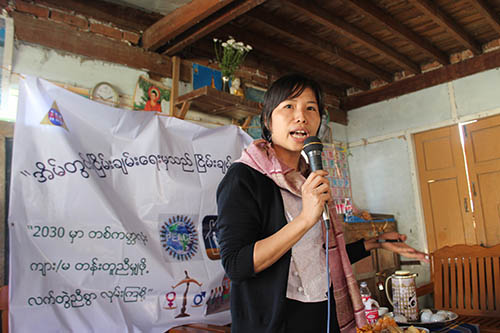 "Naw Eunice, from the Myanmar Institute of Theology, presents the message ""Gender Equality starts from the class room"" during the global campaign '16 Days of Activism Against Gender-Based Violence."