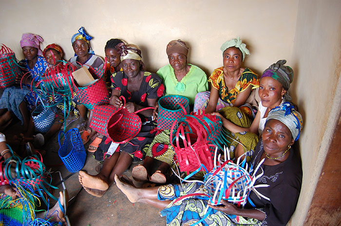 Women weave baskets in Congo