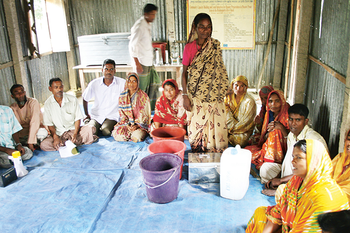 Delwara Begum in the yellow sari participates in a rescue group working with disaster preparedness in Bangladesh. Photo: Jens Aas-Hansen/Norwegian Church Aid